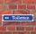 """Schild im Straßenschild-Design """"Toiletten links"""" - 3 mm Alu-Verbund - 52 x 11 cm"""