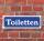 """Schild im Straßenschild-Design """"Toiletten"""" 30 x10 cm Alu-Verbund"""